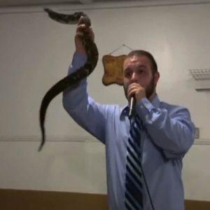 Christian snake charmer